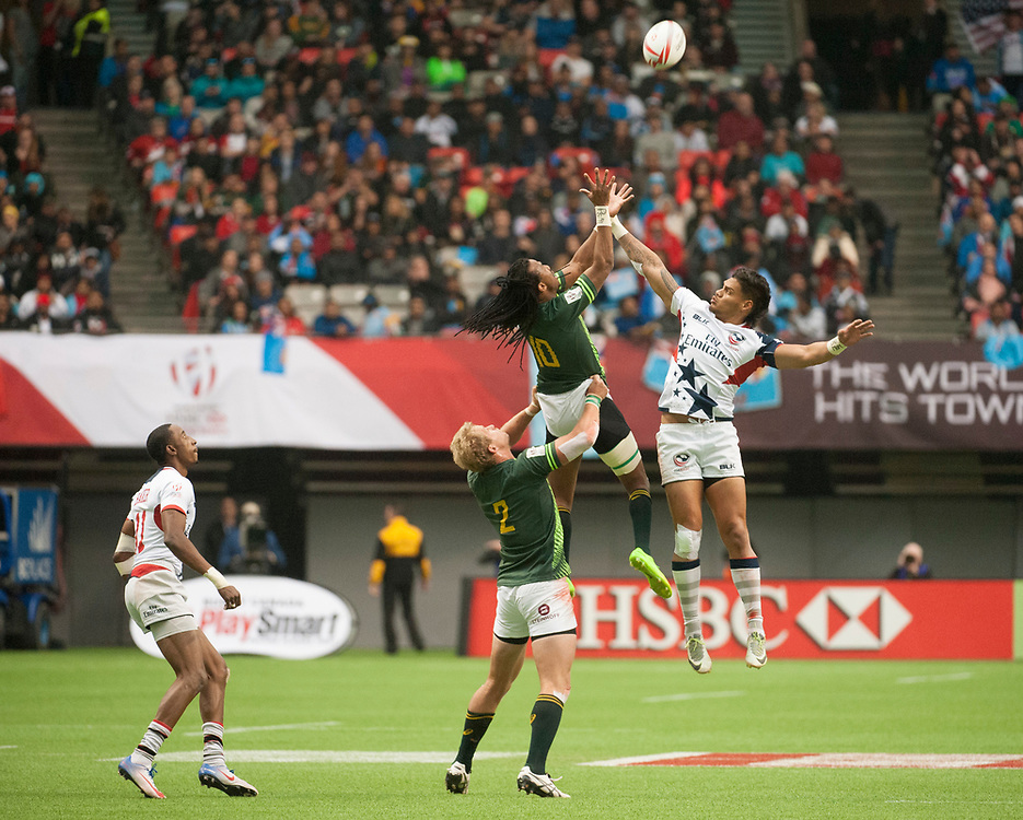 Make Unufe of the United States and Cecil Afrika go up for a kick off during the knockout stages of the Canada Sevens,  Round Six of the World Rugby HSBC Sevens Series in Vancouver, British Columbia, Sunday March 12, 2017. <br /> <br /> Jack Megaw.<br /> <br /> www.jackmegaw.com<br /> <br /> jack@jackmegaw.com<br /> @jackmegawphoto<br /> [US] +1 610.764.3094<br /> [UK] +44 07481 764811