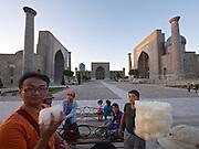 Uzbekistan, Samarqand.<br /> Registan ensemble.<br /> Sugar wool seller.