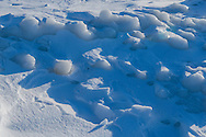 Sculpted ice and snow along the shoreline of Clear Lake in Riding Mountain National Park, Manitoba