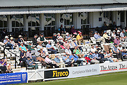 Crowd in the sunshine during day 3 of the LV County Championship Div 1 match between Sussex County Cricket Club and Worcestershire County Cricket Club at the BrightonandHoveJobs.com County Ground, Hove, United Kingdom on 21 April 2015.