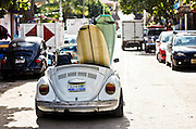 "SHOT 1/15/10 11:15:41 AM - A pair of surfboards hang out the back end of a topless Volkswagen Beetle on the streets of Sayulita, Mexico. Sayulita is a small fishing village about 25 miles north of downtown Puerto Vallarta in the state of Nayarit, Mexico, with a population of approximately 4,000. Known for its consistent river mouth surf break, roving surfers ""discovered"" Sayulita in the late 60's with the construction of Mexican Highway 200. In recent years, it has become increasingly popular as a holiday and vacation destination, especially with surfing enthusiasts and American and Canadian tourists. (Photo by Marc Piscotty / © 2009)"