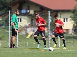 15.07.2013, Walchsee, AUT, FC Augsburg, Trainingslager, im Bild Thomas BARTH (Co-Trainer FC Augsburg) mit den Nachwuchsspielern Tim RIEDER und Eric THOMMY (re.), // during a trainings session of German 1st Bundesliga club FC Augsburg at their training camp in Walchsee, Austria on 2013/07/15. EXPA Pictures &copy; 2013, PhotoCredit: EXPA/ Eibner/ Klaus Rainer Krieger<br /> <br /> ***** ATTENTION - OUT OF GER *****