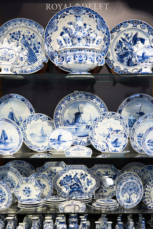 Delft Blue luxury hand-painted porcelain plates and dinner service at Royal Delft Experience shop in Amsterdam, Holland