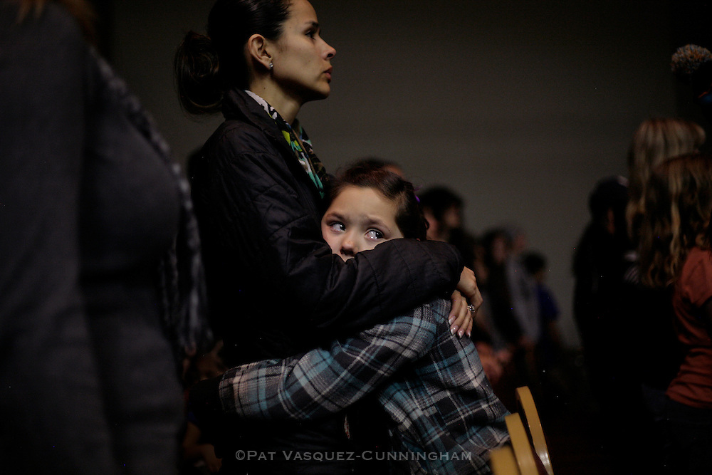 pvc011514a/1-14-14/asec.  Nine year old Raelynn Holloway (CQ), hugs her mother Rhiannon Holloway (CQ), left, during a prayer vigil for the victims of the Berrendo Middle School shooting in Roswell, N.M., photographed Tuesday Jan. 14, 2014.  (Pat Vasquez-Cunningham/Journal)
