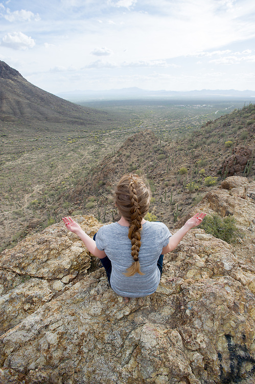 Woman meditating in desert,Tucson AZ
