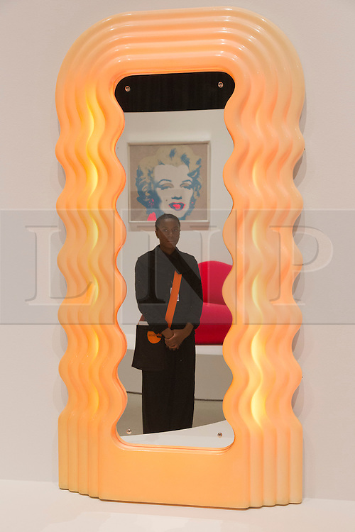 """© Licensed to London News Pictures. 21/10/2013. London, England. Ultrafragola 1970 by Ettore Sottsass with a Marilyn Monroe artwork by Andy Warhol at back. The Exhibition """"Pop Art Design"""" opens at the Barbican Art Gallery/Barbican Centre running from 22 October 2013 to 9 February 2014. The exhibition brings together 200 works by 70 artists and designers including Peter Blake, Andy Warhol and Roy Lichtenstein. Photo credit: Bettina Strenske/LNP"""
