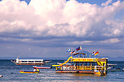 Photo shows one of the two floating bars in the bay in Sabang village, Puerto Galera, the Philippines.