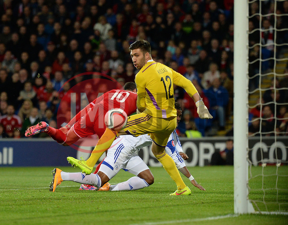 Cyprus Tasos Kissas watches Wales David Cotterill ball into the net to score. - Photo mandatory by-line: Alex James/JMP - Mobile: 07966 386802 - 13/10/2014 - SPORT - Football - Cardiff - Cardiff City Stadium - Wales v Cyprus - EURO 2016 Qualifiers