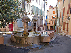 Fountain flowing into a wash tub, one of more than 40 man-made fountains in Barjols in Provence Verte. Barjols in the Var region of southern France is noted for its numerous fountains, wash houses, and old tanneries, a town shaped by water since Roman times.
