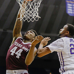 Feb 4, 2017; Baton Rouge, LA, USA; Texas A&M Aggies forward Robert Williams (44) dunks over LSU Tigers forward Aaron Epps (21) during the first half at the Pete Maravich Assembly Center. Mandatory Credit: Derick E. Hingle-USA TODAY Sports
