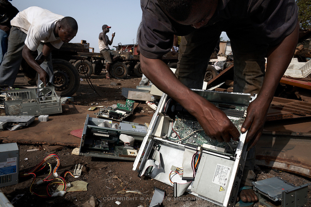 Computer hard drives are dismantled at Agbogbloshie dump, in Accra, Ghana.