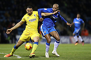 Gillingham's Josh parker battles with AFC Wimbledon defender Darius Charles (32)  during the EFL Sky Bet League 1 match between Gillingham and AFC Wimbledon at the MEMS Priestfield Stadium, Gillingham, England on 21 February 2017.