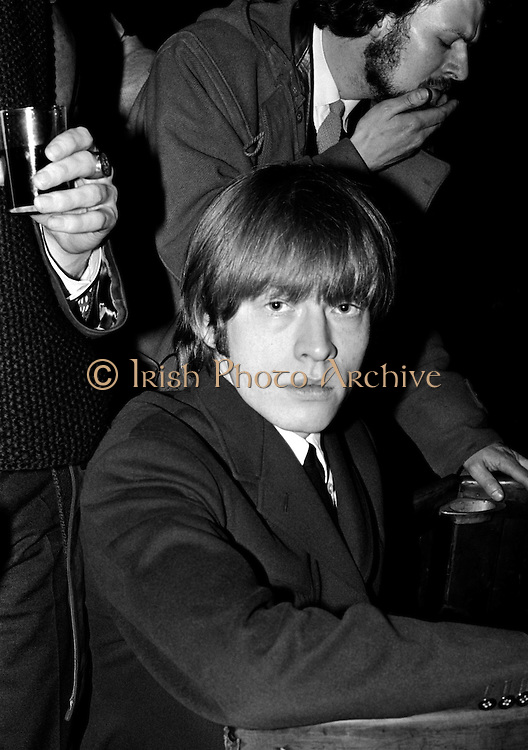 The Rolling Stones Charlie is my Darling - Ireland 1965. Brian Jones poses for the cameras at the Rolling Stones press conference at the Adelphi Theatre, Middle Abbey Street, Dublin. Birthday gift ideas of a Limited Edition Prints of Brain Jones, The Rolling Stones, Charlie is my Darling, Ireland 1965. <br />