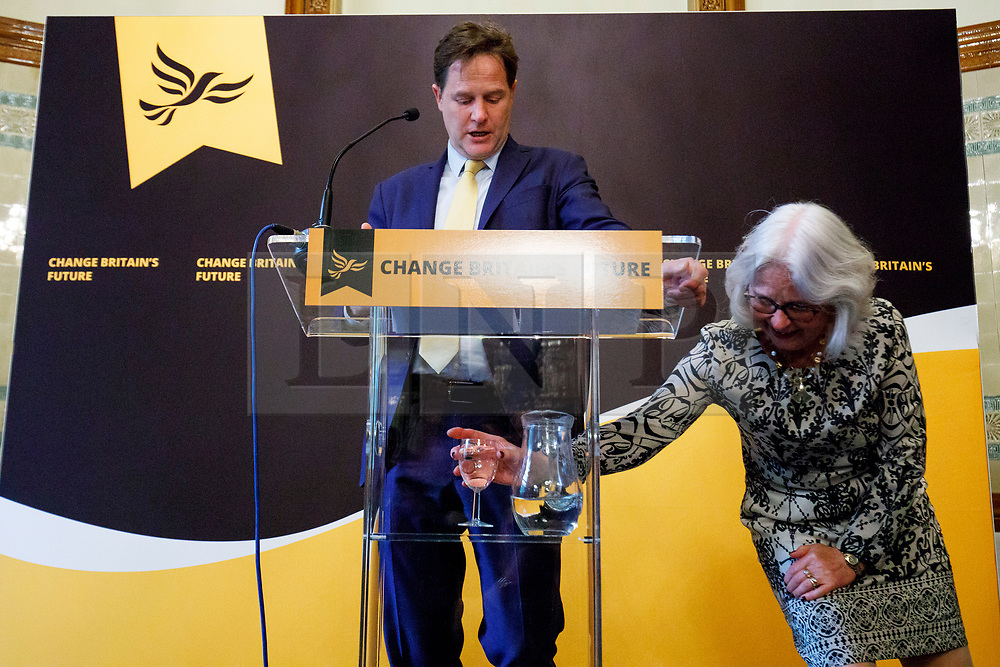 © Licensed to London News Pictures. 02/05/2017. London, UK. A glass of water is being replaced whilst former Liberal Democrat leader NICK CLEGG making his first intervention of the election campaign and sets out the party's position on Europe and Brexit ahead of the 2017 General Election at The National Liberal Club in London on 2 May 2017. Photo credit: Tolga Akmen/LNP