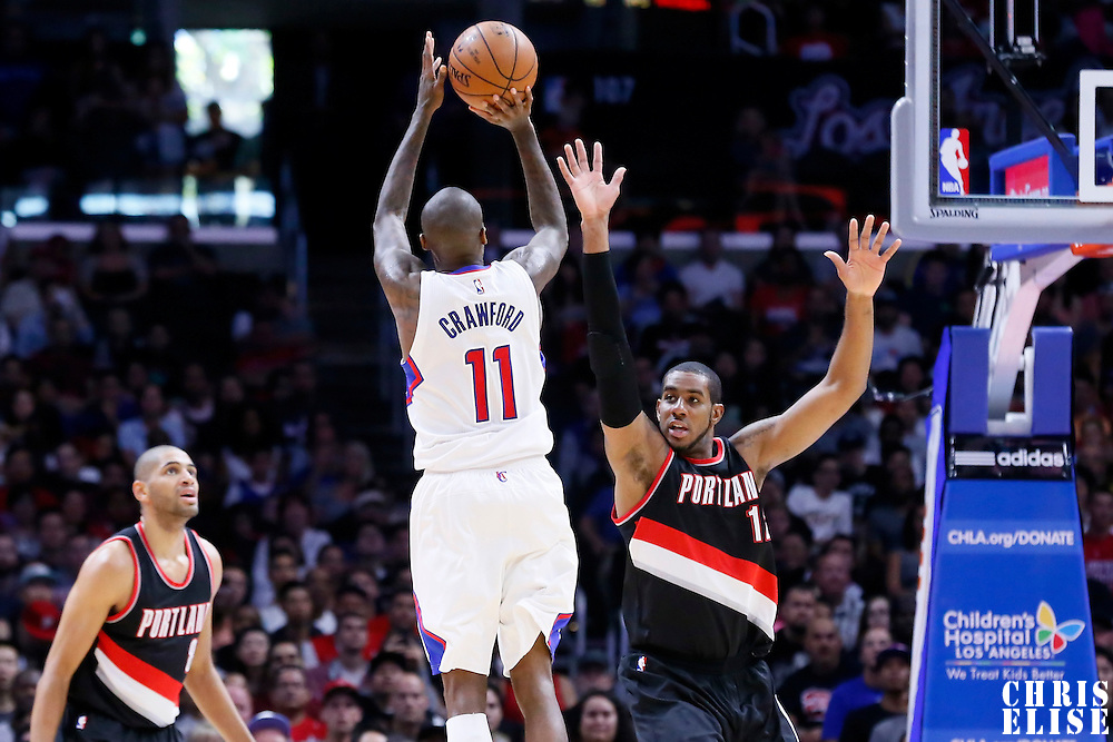 08 November 2014: Los Angeles Clippers guard Jamal Crawford (11) takes a jump shot over over Portland Trail Blazers forward LaMarcus Aldridge (12) during the Los Angeles Clippers 106-102 victory over the Portland Trail Blazers, at the Staples Center, Los Angeles, California, USA.