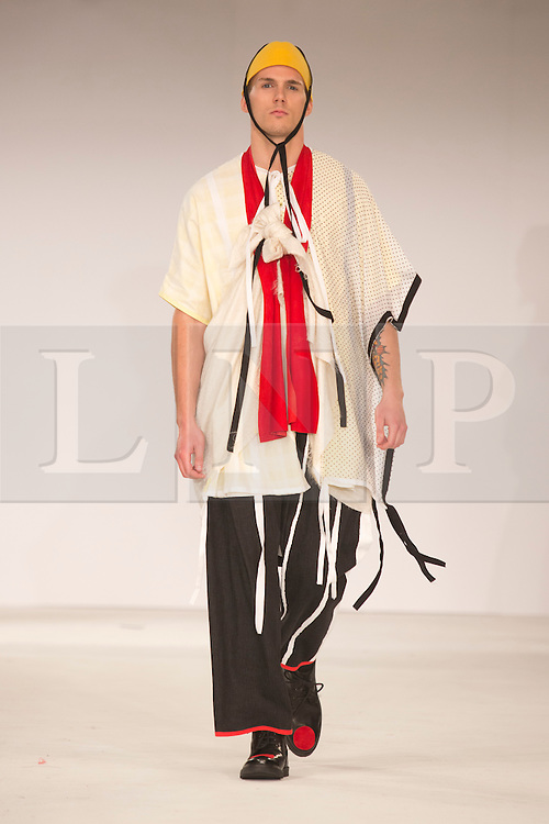 © Licensed to London News Pictures. 31/05/2014. London, England. Collection by Bella McLeod from Edinburgh College of Art. Graduate Fashion Week 2014, Runway Show at the Old Truman Brewery in London, United Kingdom. Photo credit: Bettina Strenske/LNP