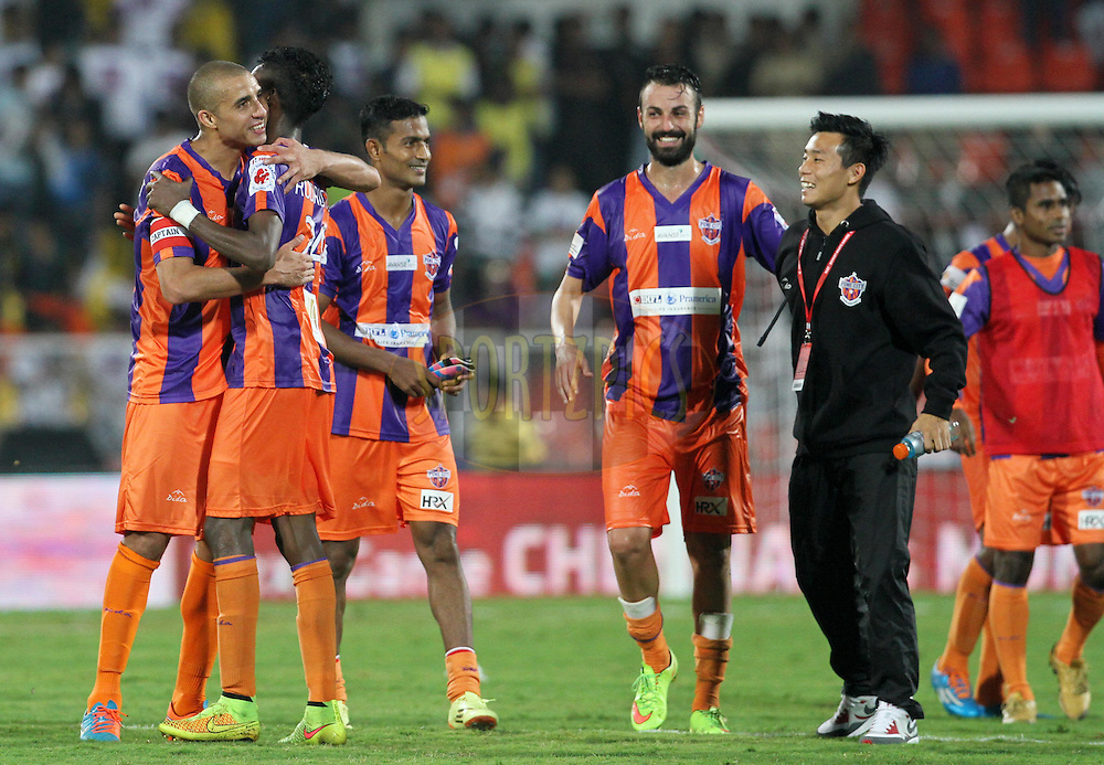 FC Pune City players celebrates after winning the match 14 of the Hero Indian Super League between FC Pune City and FC Goa held at the Shree Shiv Chhatrapati Sports Complex Stadium, Pune, India on the 26th October 2014.<br /> <br /> Photo by:  Vipin Pawar/ ISL/ SPORTZPICS