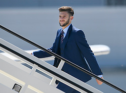 © Licensed to London News Pictures. 06/06/2016. Luton, UK. ADAM LALLANA joins other members of England national football squad as they board a plane at Luton airport in Bedfordshire, England, to head for their training camp in France, ahead of the start of the UEFA Euro 2016 championships.  Photo credit: Ben Cawthra/LNP