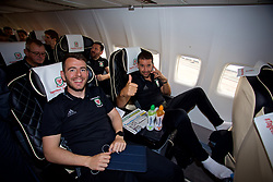 CARDIFF, WALES - Monday, September 4, 2017: Wales' Ronan Kavanagh and sports science coach Adam Owen boards the team plane as the squad depart Cardiff Airport to travel to Chișinău ahead of the 2018 FIFA World Cup Qualifying Group D match against Moldova. (Pic by David Rawcliffe/Propaganda)