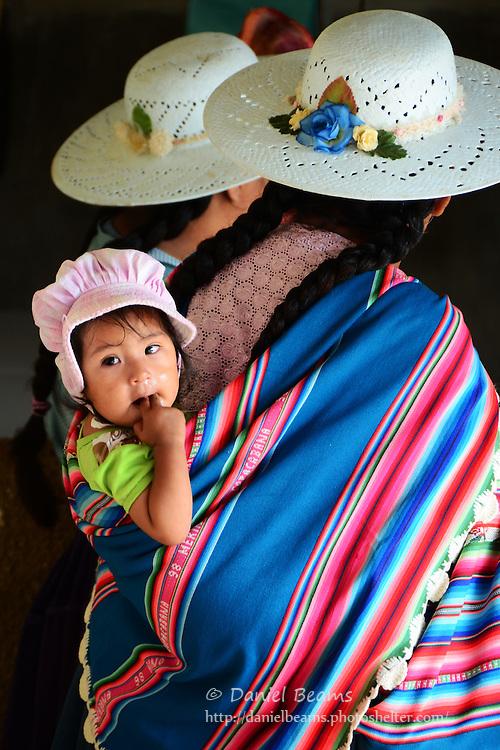 Women and baby at the market in Samaipata, Bolivia