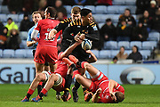 Wasps centre Malakai Fekitoa (13) looks to offload in the tackle during the Gallagher Premiership Rugby match between Wasps and Saracens at the Ricoh Arena, Coventry, England on 21 February 2020.