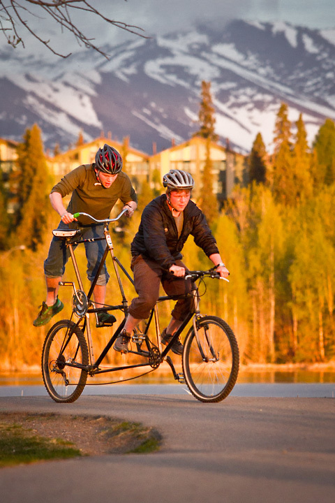 David Hansen and his brother, Mark, test ride David's  experimental bicycle near Westchester Lagoon, Anchorage.