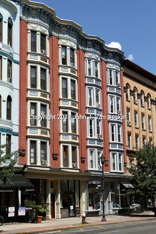 Many 19th century Row Houses and condominium and apartment building line Washington Street, the main thoroughfare in Hoboken, New Jersey, USA. Most buildings house shops as the street serves as a center for shopping and restaurants. A one-time transportation and warehouse hub, Hoboken has gone through a gentrification over the last 30 years and has transformed itself into an upscale community across the Hudson River from New York City.