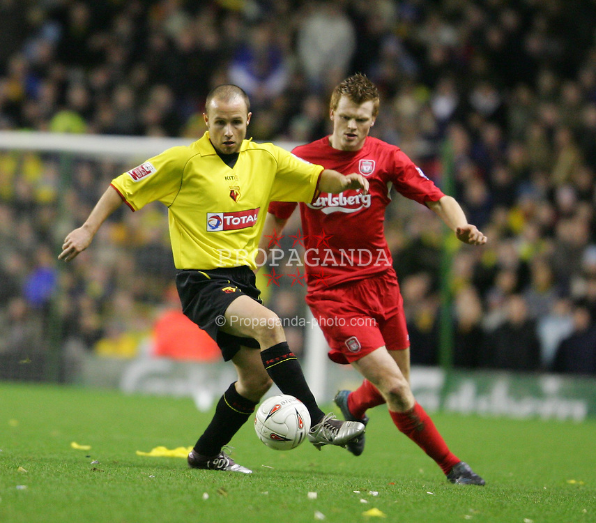 LIVERPOOL, ENGLAND - TUESDAY JANUARY 11th 2005: Liverpool's John Arne Riise and Watford's Paul Devlin during the League Cup Semi-Final 1st Leg at Anfield. (Pic by David Rawcliffe/Propaganda)