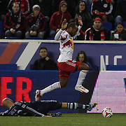 Thierry Henry, New York Red Bulls, evades the challenge of Aurelien Collin, Sporting Kansas City, during the New York Red Bulls V Sporting Kansas City, Major League Soccer Play Off Match at Red Bull Arena, Harrison, New Jersey. USA. 30th October 2014. Photo Tim Clayton