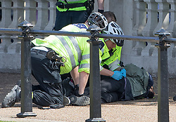 © Licensed to London News Pictures. 24/05/2017. London, UK. Police search a man as they detain him opposite Buckingham Palace just before the Changing of the Guard ceremony. Today's ceremonu has been cancelled.  The terrorism threat level has been raised to critical and Operation Temperer has been deployed. 5,000 troops are taking over patrol duties under police command. Photo credit: Peter Macdiarmid/LNP