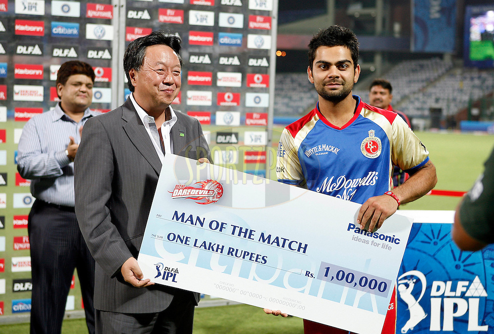 Virat Kohli of Royal Challengers Bangalore receives the man of the match award during match 30 of the Indian Premier League ( IPL ) Season 4 between the Delhi Daredevils and the Royal Challengers Bangalore held at the Feroz Shah Kotla Stadium in Delhi, India on the 26th April 2011..Photo by Money Sharma/BCCI/SPORTZPICS