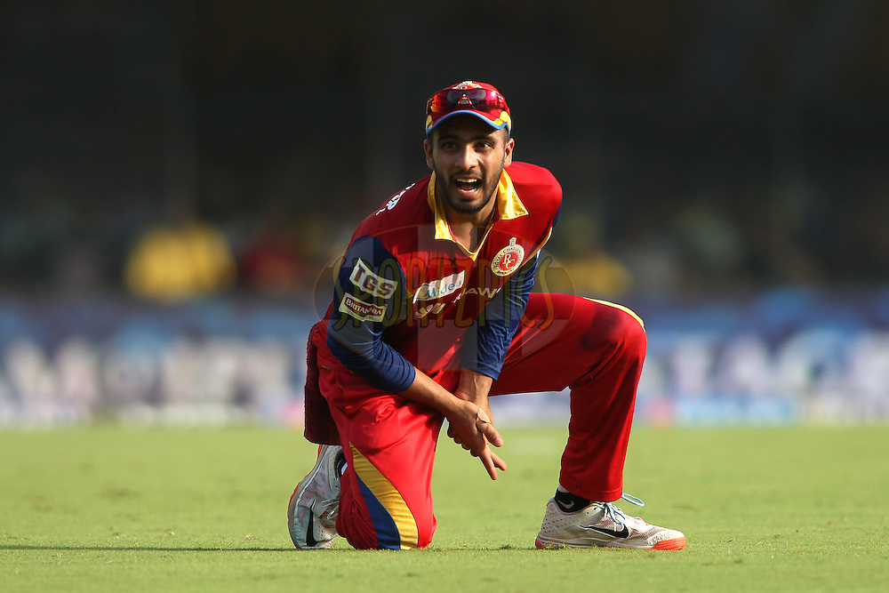 Mandeep Singh of the Royal Challengers Bangalore reacts after injuring his finger during match 37 of the Pepsi IPL 2015 (Indian Premier League) between The Chennai Superkings and The Royal Challengers Bangalore held at the M. A. Chidambaram Stadium, Chennai Stadium in Chennai, India on the 4th May April 2015.<br /> <br /> Photo by:  Shaun Roy / SPORTZPICS / IPL