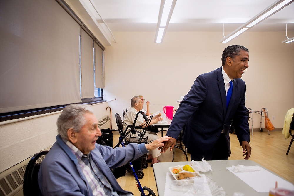 NEW YORK, NY - JUNE 28, 2016: Congressional candidate and New York State Senator Adriano Espaillat greets residents at the Y of Washington Heights in New York, New York. CREDIT: Sam Hodgson for The New York Times.