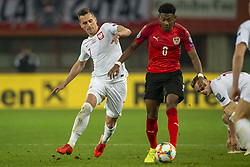 March 21, 2019 - Vienna, Austria - David Alaba of Austria fights for the ball with Arkadiusz Milik of Poland during the UEFA European Qualifiers 2020 match between Austria and Poland at Ernst Happel Stadium in Vienna, Austria on March 21, 2019  (Credit Image: © Andrew Surma/NurPhoto via ZUMA Press)