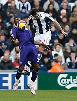 Photo: Steve Bond/Richard Lane Photography. West Bromwich Albion v Newcastle United. Barclays Premiership. 07/02/2009. Shola Ameobi (L) and Carl Hoefkens (R) go for the ball