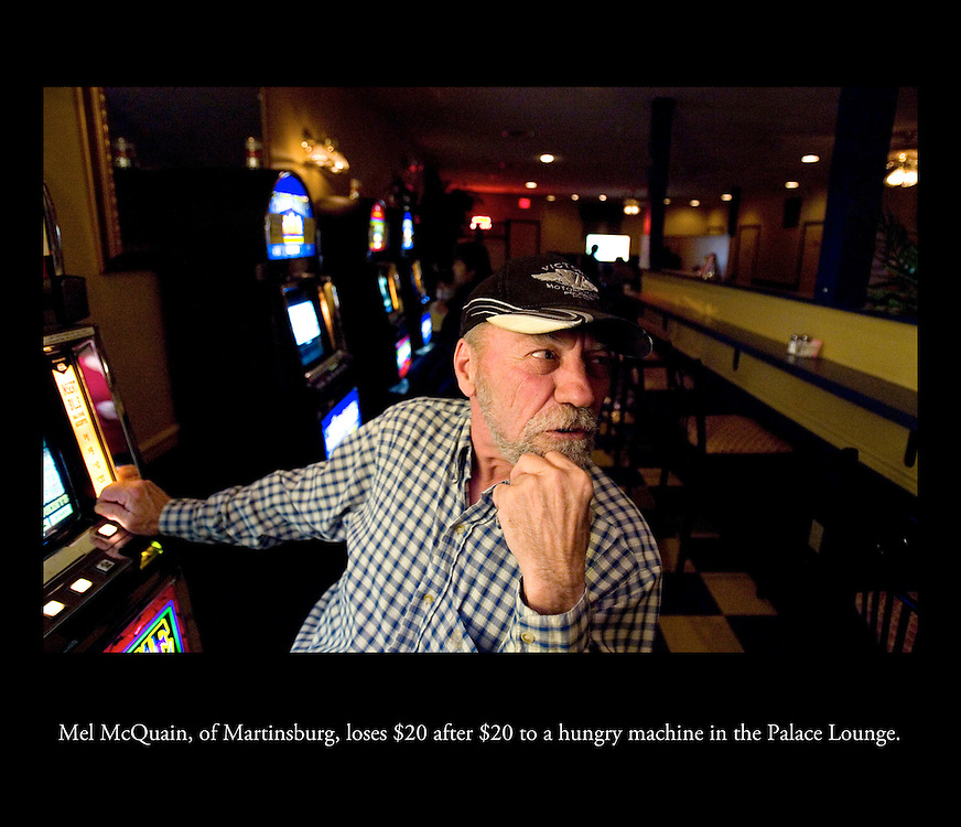While his fiance wins on her machine, Mel McQuain, of Martinsburg, loses $20 after $20 to a hungry machine in the Palace Lounge..DANA FELTHAUSER, The Patriot-News