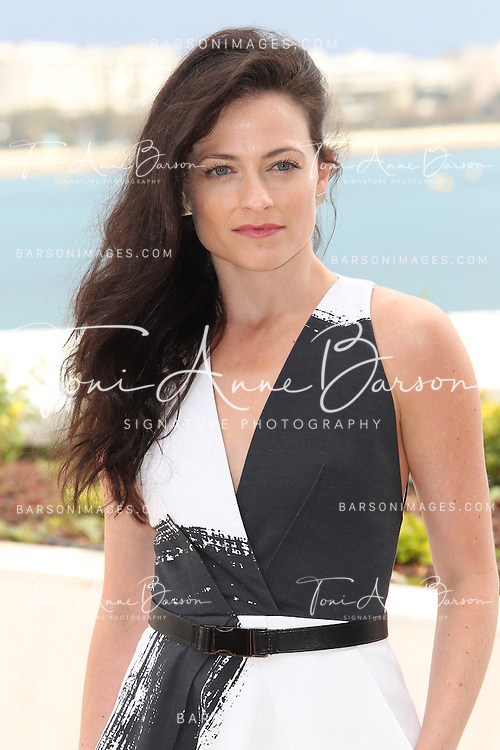CANNES, FRANCE - APRIL 08:  British actress Lara Pulver attends  photocall for the TV serie 'Da Vinci's Demons' at MIP TV 2013 on April 8, 2013 in Cannes, France.  (Photo by Tony Barson/Getty Images)