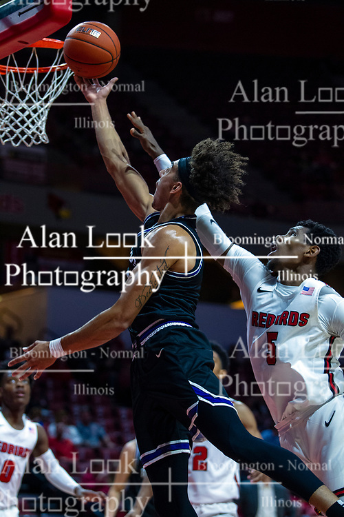 NORMAL, IL - October 23: Brodric Thomas slips a shot past Keith Fisher III during a college basketball game between the ISU Redbirds and the Truman State Bulldogs on October 23 2019 at Redbird Arena in Normal, IL. (Photo by Alan Look)