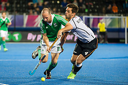 Ireland's Peter Caruth is tackled by Lukas Windfeder og Germany. Ireland v Germany - Unibet EuroHockey Championships, Lee Valley Hockey & Tennis Centre, London, UK on 23 August 2015. Photo: Simon Parker