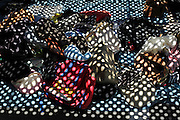 various clothing at a flea market with grating shadow projection