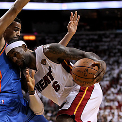 Jun 17, 2012; Miam, FL, USA; Miami Heat small forward LeBron James (6) is guarded by Oklahoma City Thunder shooting guard Thabo Sefolosha (2) during the third quarter in game three in the 2012 NBA Finals at the American Airlines Arena. Mandatory Credit: Derick E. Hingle-US PRESSWIRE
