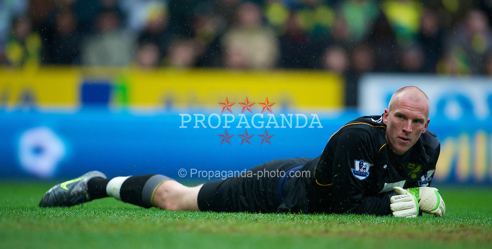 NORWICH, ENGLAND - Saturday, April 28, 2012: Norwich City's goalkeeper John Ruddy looks dejected as Liverpool score the second goal during the Premiership match at Carrow Road. (Pic by David Rawcliffe/Propaganda)