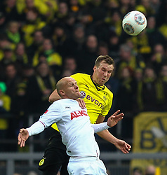 25.01.2014, Signal Iduna Park, Dortmund, GER, 1. FBL, Borussia Dortmund vs FC Augsburg, 18. Runde, im Bild Kopfballduell zwischen Tobias Werner (FC Augsburg #13), Kevin Grosskreutz (Bor Dortmund, re ), Aktion, Zweikampf, Hochformat, hoch, vertikal // during the German Bundesliga 18th round match between Borussia Dortmund and FC Augsburg at the Signal Iduna Park in Dortmund, Germany on 2014/01/26. EXPA Pictures &copy; 2014, PhotoCredit: EXPA/ Eibner-Pressefoto/ Krieger<br /> <br /> *****ATTENTION - OUT of GER*****