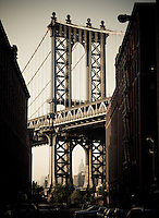 The Empire State Building seen through a portion of the Manhattan Bridge, Brooklyn, NY.