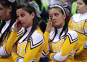 (030809 Lowell, MA) Bishop Fenwick's cheerleaders cry after Watertwon beats their team in the North Sectional Basketball Championship game held at Tsongas Arena.