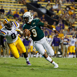 Sep 8, 2018; Baton Rouge, LA, USA; Southeastern Louisiana Lions quarterback Chason Virgil (9) runs from LSU Tigers linebacker Patrick Queen (8) during the second half of a game at Tiger Stadium. LSU defeated Southeastern 31-0. Mandatory Credit: Derick E. Hingle-USA TODAY Sports