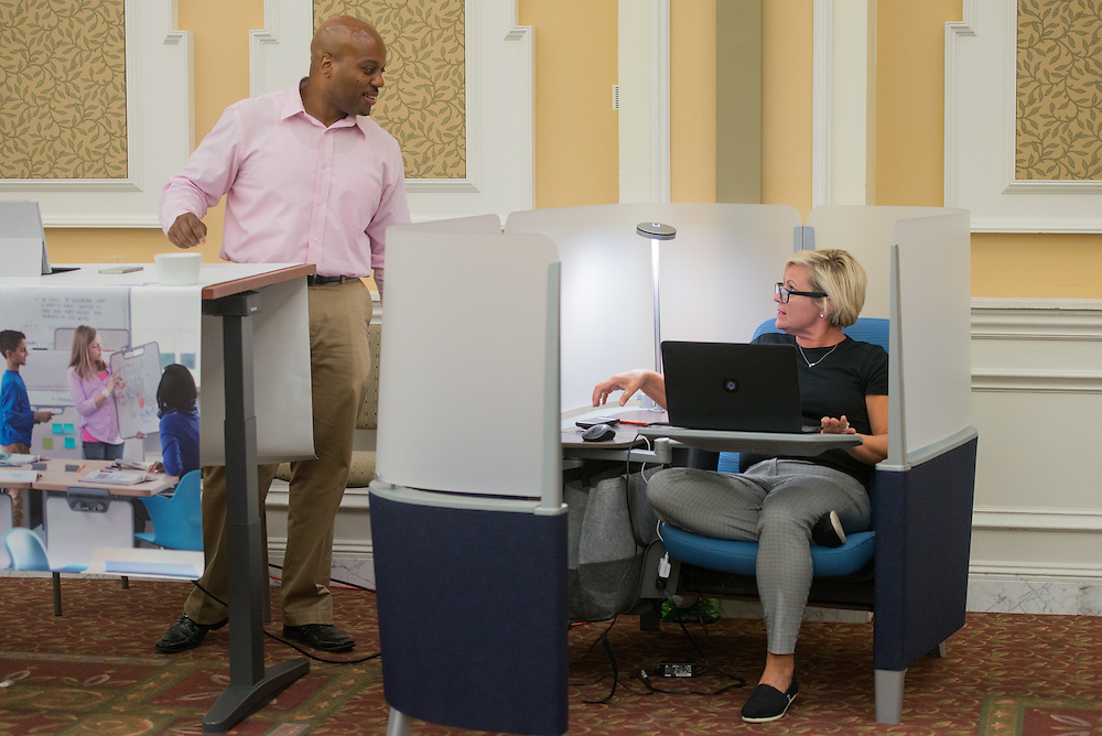 Dwayne Hall, of Steelcase, and Mary Pizzurro, of L.O.T.H. attend the 1st Annual Supplier Fair held at Ohio University's Baker Center Ballroom on September 7, 2016.