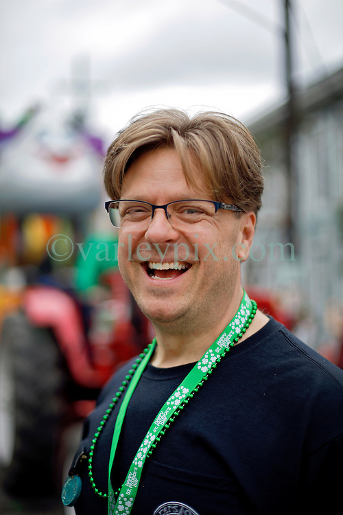 12 March 2016. New Orleans, Louisiana.<br /> Paul Ribka at the Irish Channel St Patrick's Day parade as the procession makes its way along Magazine Street.<br /> Photo©; Charlie Varley/varleypix.com
