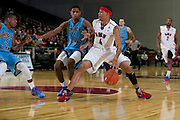 GARLAND, TX - NOVEMBER 11: Keith Frazier #4 of the SMU Mustangs drives to the basket against the Rhode Island Rams on November 11, 2013 at the Curtis Culwell Center in Garland, Texas.  (Photo by Cooper Neill/Getty Images) *** Local Caption *** Keith Frazier