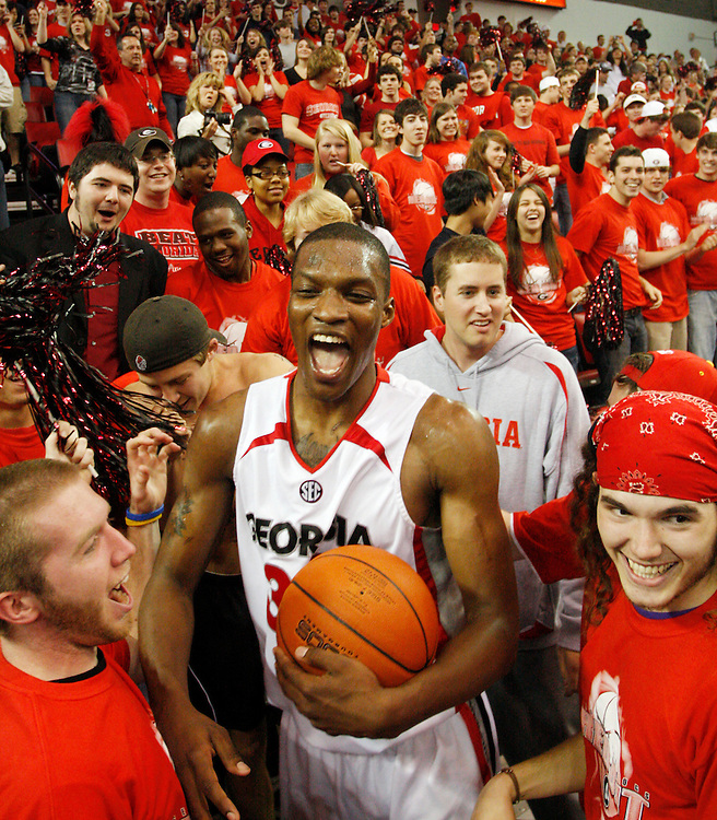 Georgia's Terrance Woodbury celebrates with Georgia basketball fans Saturday, Feb. 14, 2009 at Stegeman Coliseum after the Bulldogs' 88-86 victory over the Florida Gators in Athens.  The last second victory for the Bulldogs ended an 11 game losing streak.